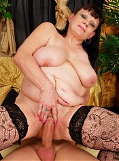 Kinky mama taking on a hard young cock
