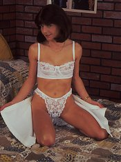 Mature housewife showing off hairy beaver