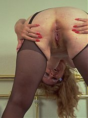 This older slut really loves to show her cunt