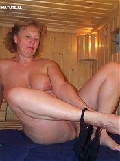 Mature slut pleasing herself in the sauna