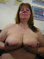 Big titted mature slut showing and sucking