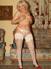 Lesbo grandmas Francesca and Erlene give each other a wild pussy teasing in their lingerie live