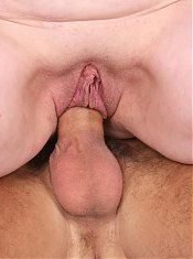 Redhead mature Simone lets her huge saggy tits hang while riding a cock on the couch live